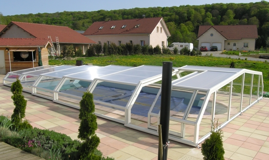 The side view of a low 5 angle white pool enclosure