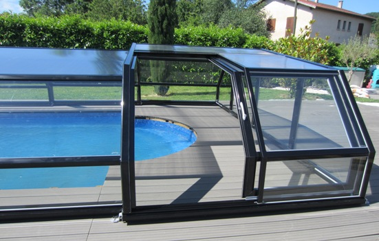 Side access to a low 5 angle pool enclosure.