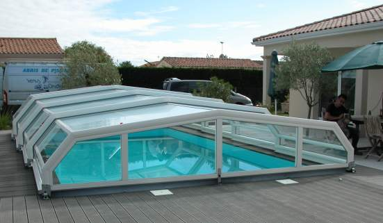 A low pool enclosure on decking in white