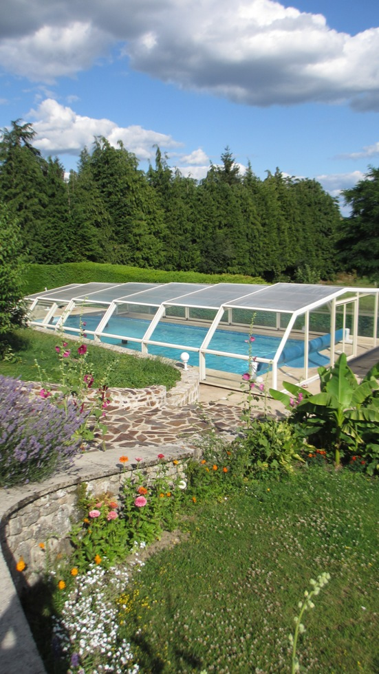 The 5 angle pool enclosure shown in the extended position