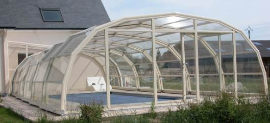 The exterior view of a 9 Angle Ivory Pool enclosure.
