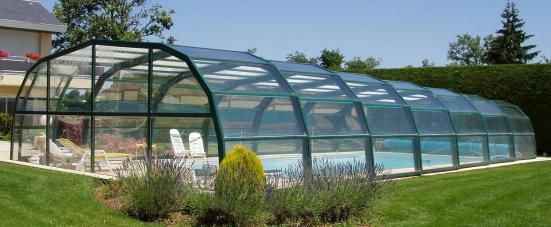 The exterior view of a 9 Angle Ondine Pool enclosure in Green