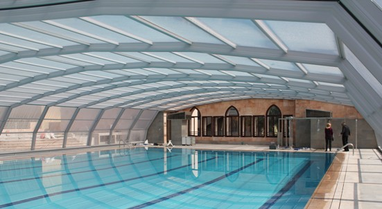 The interior view of a 9 Angle pool enclosure in metallic grey
