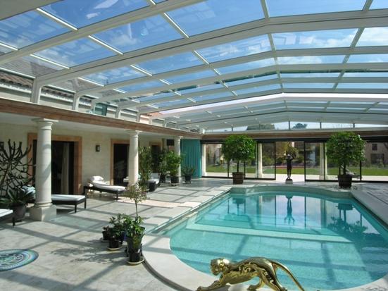 Abris piscine fa ades abri adoss la maison abri for Maison toit en verre